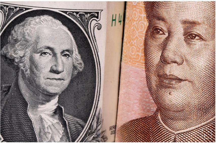Dollar Mỹ và Nhân dân tệ. Nguồn: Reuters